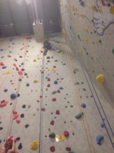 Peyton rock climbing.