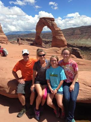Obligatory family photo in front of Delicate Arch