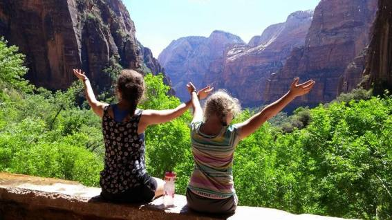 The girls under the weeping rock, looking out towards the canyon.