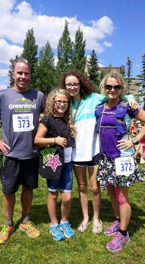 Our family at the finish line. The girls got to see us finish!