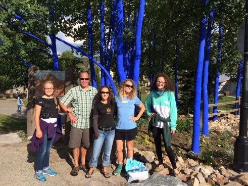 Hanging out in front of the blue trees in downtown Breckenridge