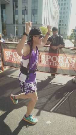 Kim, finishing her first ever marathon, finishing for Dixie, her mom, who passed away from PC two years ago.