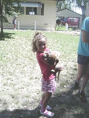 Riley holding Greta